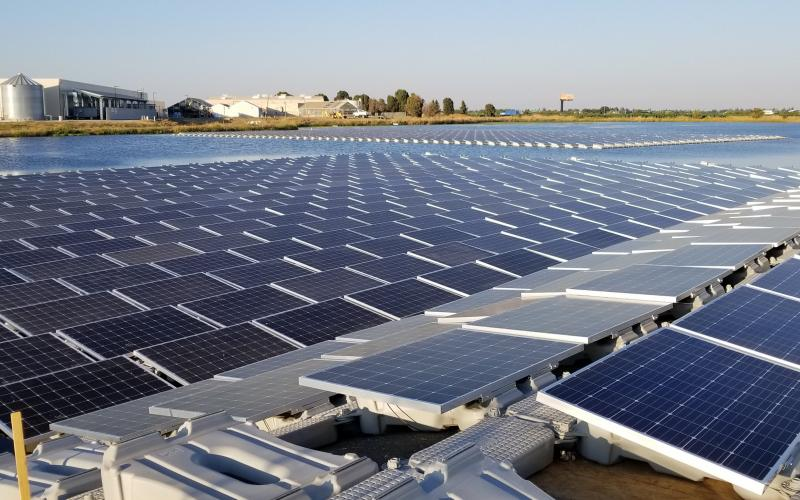 close-up floating solar array on irrigation pond | Salad Cosmo