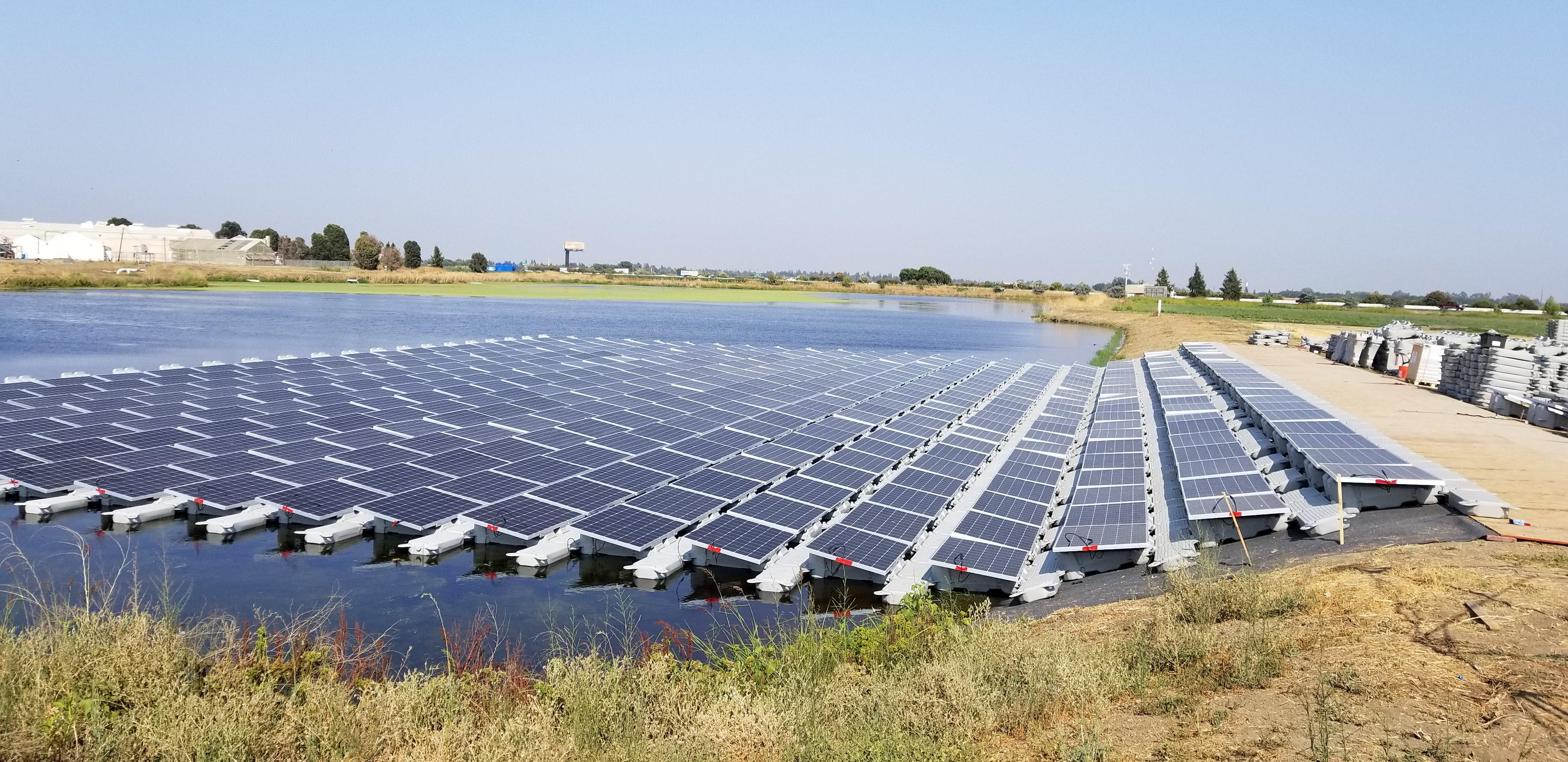 Floating Solar Array installed on an irrigation pond for Salad Cosmo