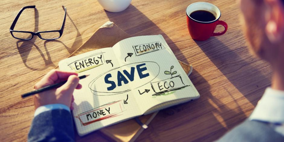 saving energy, money notes in a notebook
